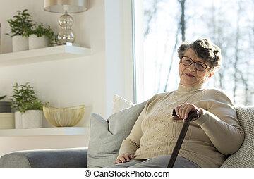 Senior woman with walking stick