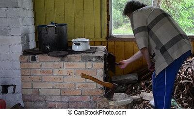 senior woman wood stove
