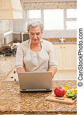 Senior woman working on her laptop