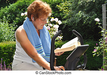 Senior woman working out and reading