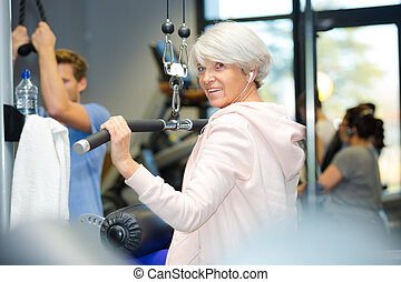 senior woman working out in gym