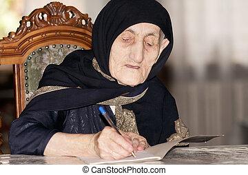 Senior woman writing