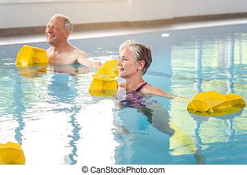 Rehabilitation training in a water gymnastics class