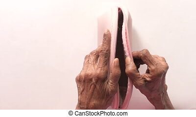 senior women hand open an empty wallet with copy space..