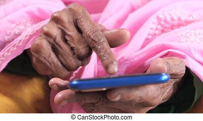senior women hand using smart phone close up .