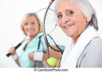 senior women playing tennis
