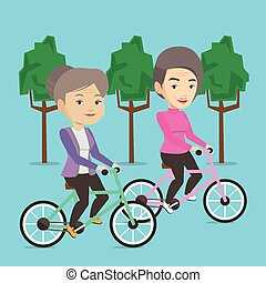 Senior women riding on bicycles in the park