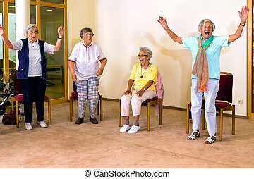 Senior women standing and sitting for exercise - Group of...