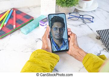 senior women taking online consultation with doctor on smart phone