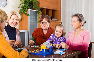 Senior women with child at desk with bingo