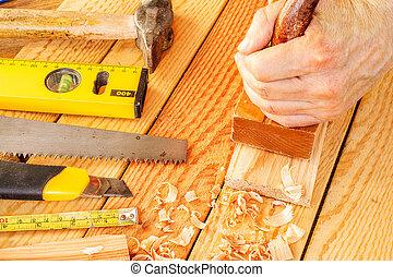 Senior woodworker or carpenter doing woodworking