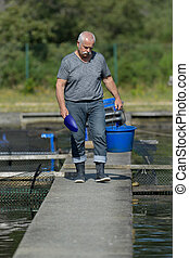 senior worker checking the quality control of pure spring water