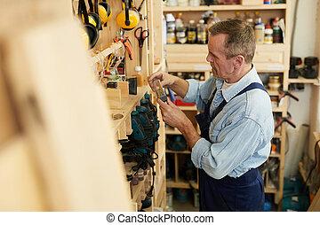 Senior Worker Choosing Tools