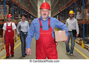 senior worker with box