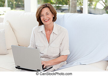 Senior working on her laptop