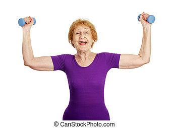 Senior Workout - Success - A fit pretty senior woman lifting...