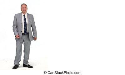 senior, zakenman, in, kostuum, kijken naar van het fototoestel