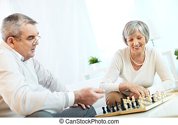 Seniors at leisure - Senior couple playing chess