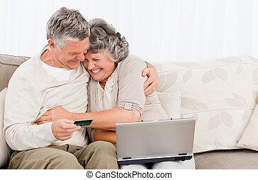 Seniors buying something on internet