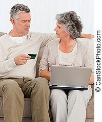Seniors buying something on internet at home