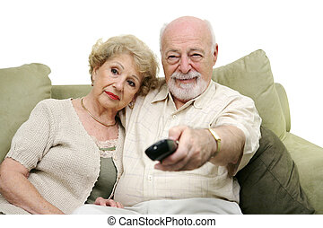 Seniors watching television together and switching channels. White background.
