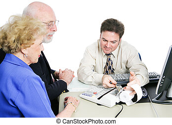 Seniors Consult Tax Accountant - Senior couple consulting an...