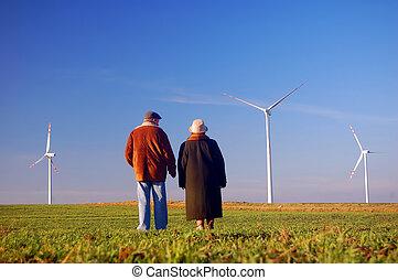 Seniors' couple and wind turbines