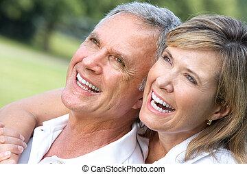 seniors couple - Happy elderly seniors couple in park