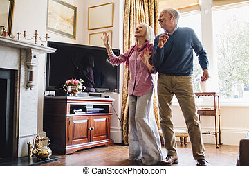 Seniors Dancing At Home - Senior couple are enjoying a dance...