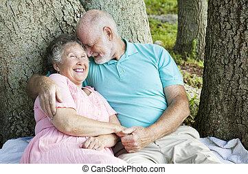 Seniors Flirting Like Teenagers - Senior couple in love....