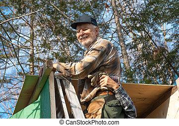 Seniors framing an hunter cabin