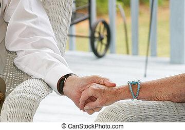Seniors holding hand - Seniors on a porch holding hands
