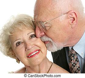 Seniors In Love - Closeup of a loving senior man gives his...