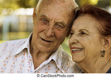 seniors in love - focus point on left woman eye, special ...