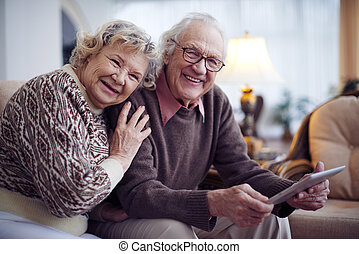 Seniors in sweaters - Affectionate senior couple having rest...