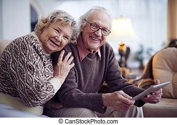 Seniors in sweaters - Affectionate senior couple having rest...