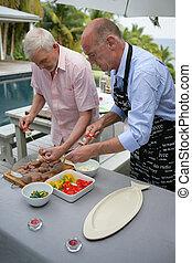 seniors making a barbecue