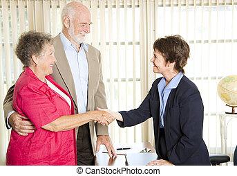 Seniors Meeting Financial Advisor - Senior couple meets with...