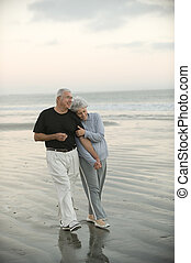 Seniors on the Beach - Senior couple walking the beach