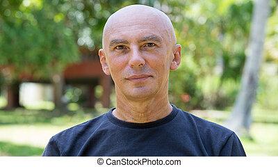 Seniors portrait, contemplative old caucasian man staring at...
