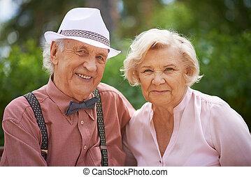 Seniors - Portrait of senior couple looking at camera