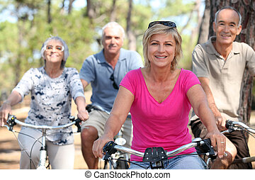seniors riding bicycles in the park