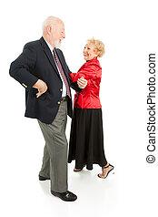 Seniors Square Dancing - Happy senior couple having a great...
