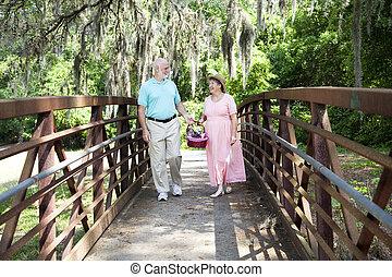 Seniors Strolling in Park