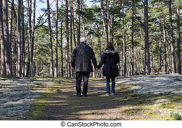 Seniors walking in the forest