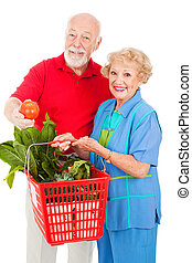 Seniors with Organic Produce - Healthy senior couple...