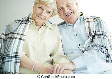 Seniors with tartan - Portrait of cheerful senior couple...