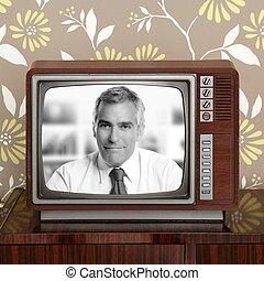 senoir tv presenter in retro wood television
