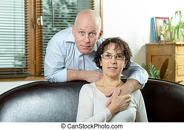 senoirs couple on a sofa