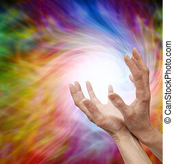 Outstretched healing hands on vortex swirling energy background